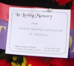 14. The card on CHAA's wreath.